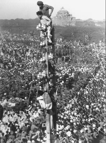 People watching Mohandas K. Gandhi's funeral from tower. (Photo by Margaret Bourke-White/The LIFE Picture Collection via Getty Images)