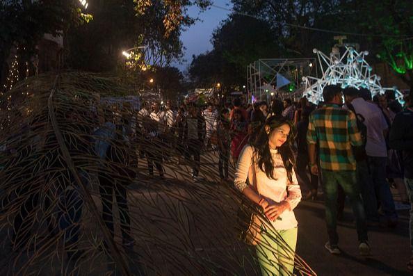 A girl examines an installation at Kala Ghoda Art Festival in Mumbai, India. (Photo by Pratik Chorge/Hindustan Times via Getty Images)
