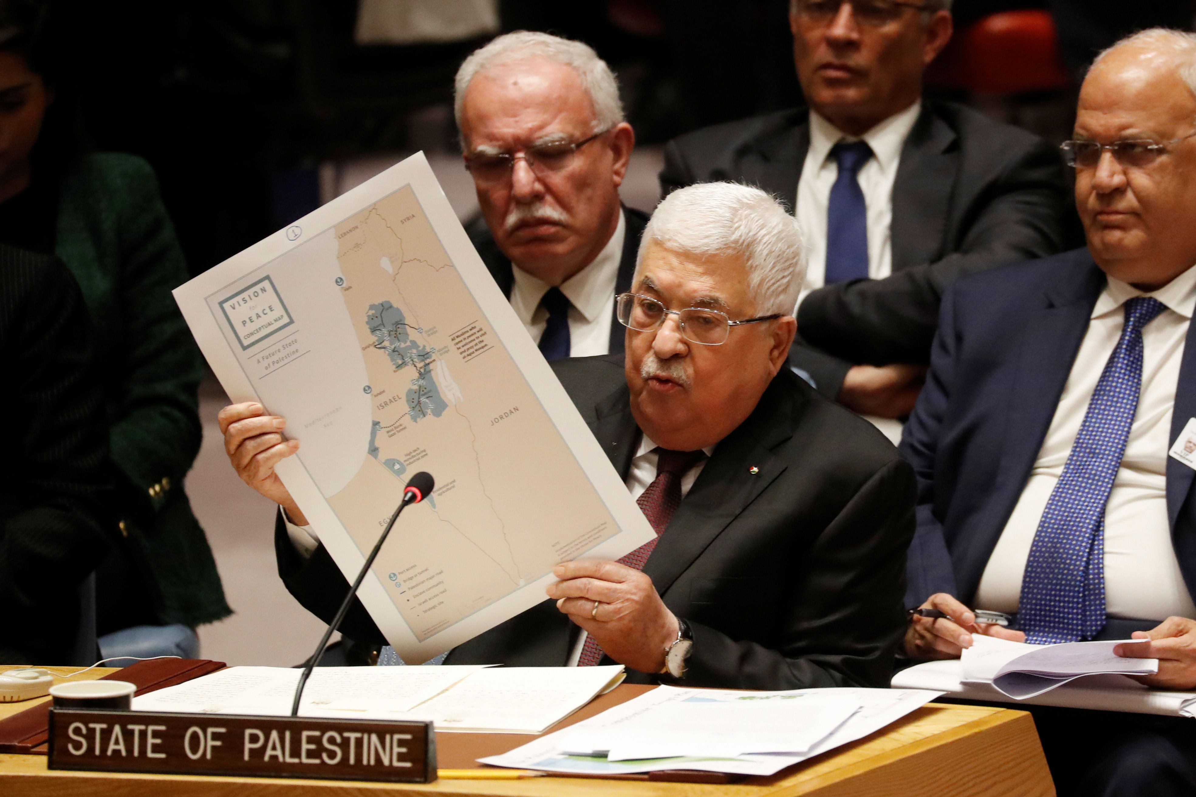 Palestinian President Mahmoud Abbas holds a document while speaking during a Security Council meeting at the United Nations in New York on Tuesday. (PHOTO: Reuters)