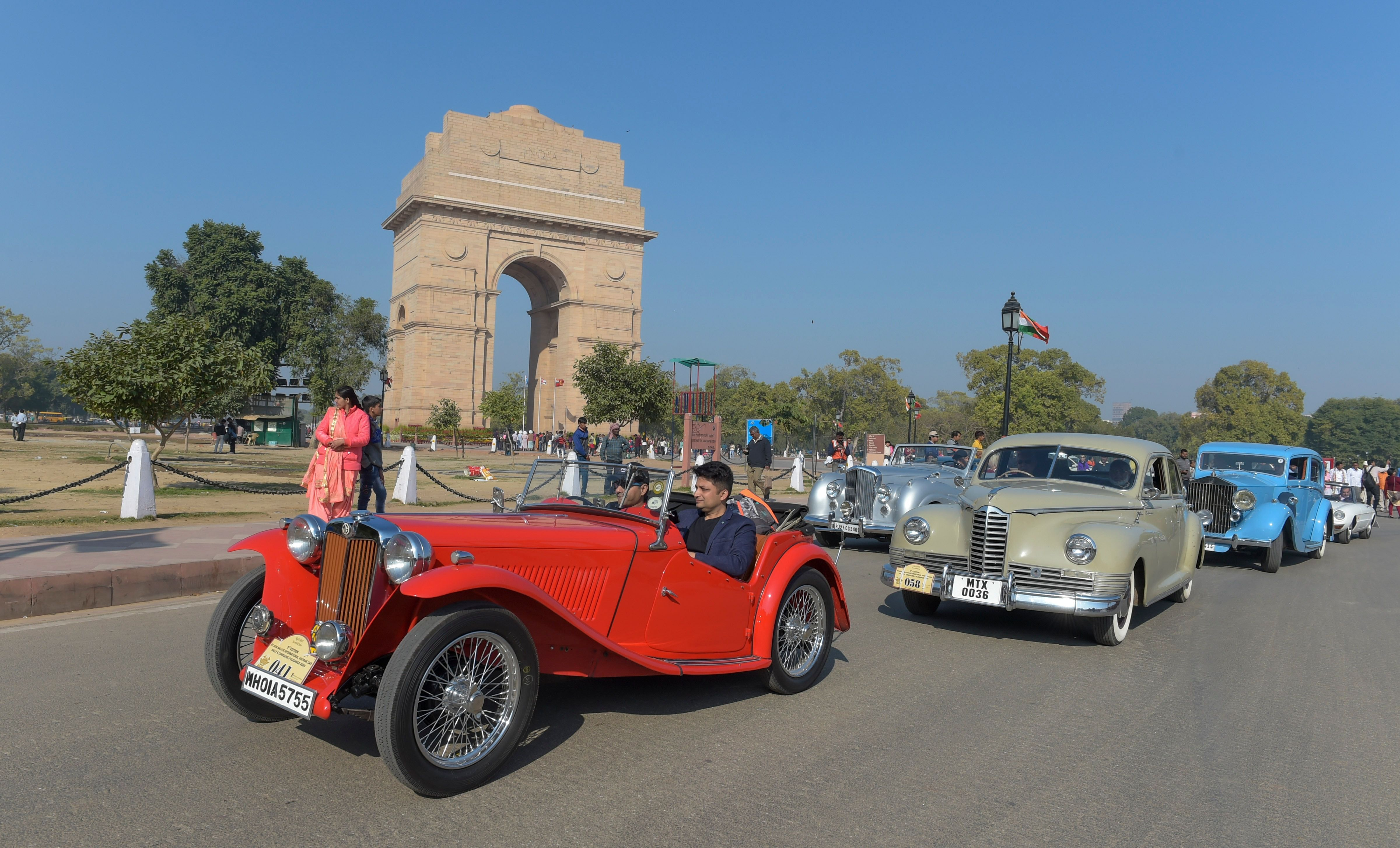 Participants drive the 1932 MG J2 followed by other vintage cars.
