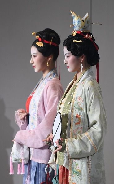 Two women display the charm of traditional Han clothing of the Song Dynasty (960-1279) at China National Silk Museum on May 23, 2020 in Hangzhou, Zhejiang Province of China. A festival about the Song Dynasty Hanfu was held in the museum on Saturday. (Photo by Wang Gang/China News Service via Getty Images)