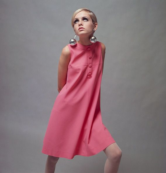 British Model Twiggy, (Lesley Hornby) wearing a pale pink mini dress and large 'bauble' earrings, 3rd December 1966. (Photo by Popperfoto via Getty Images/Getty Images