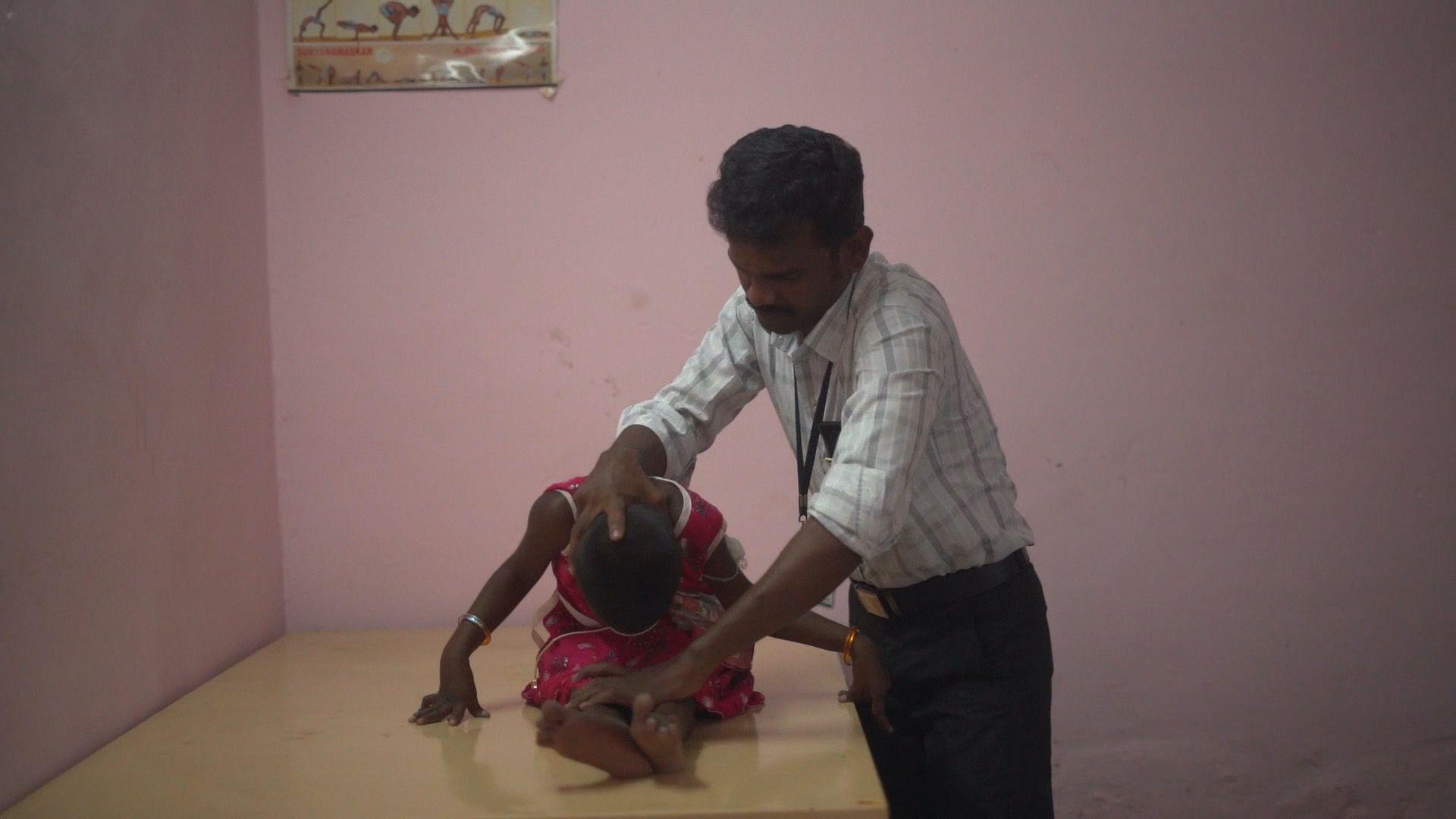 Physiotherpist K. Murugan with student | Photo Courtesy: Aparna Ganesan