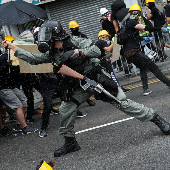 Police fire tear gas, rubber bullets in Hong Kong clash over anti-triad march